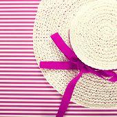 White Straw Sunhat On A Striped Magenta Background