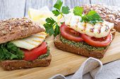 Sandwiches with pesto, vegetables and haloumi