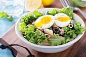 Salad with greens, pasta, tuna and egg