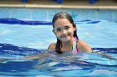 Little Hispanic Girl in Swimming Pool