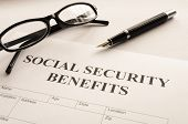 image of social-security  - social security benefits form showing financial concept in office - JPG