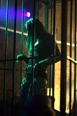 dancing woman in a steel cage