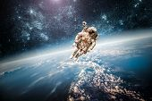 stock photo of planet earth  - Astronaut in outer space against the backdrop of the planet earth - JPG