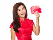 Chinese woman hold with traditional pocket money