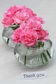 Thank you card with pink carnations in little glass jars