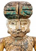 stock photo of primitive  - Old primitive carved colorful sculpture of an ancient Oriental soldier isolated on a white background - JPG