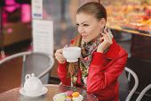 Woman model with a cup of hot drink.