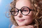 Portrait Of  Girls Schoolgirl In Glasses Looking.