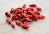 Heap of Dry Goji Berries on the Wooden Table. Healthy Diet