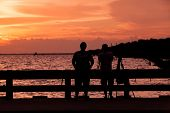 stock photo of  friends forever  - Couple of best friends on silhouette sunset.