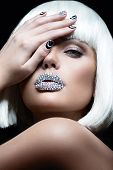 Elegant beautiful girl in a white wig, with the lips of rhinestones and festive manicure.Beauty face