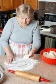 picture of grandma  - Senior woman or grandma making pie in her home kitchen - JPG