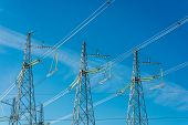 stock photo of transmission lines  - High voltage transmission line on the background of blue sky - JPG