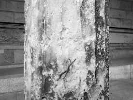 picture of raid  - Column damaged by air raid bombing during WW2 in Berlin Museumsinsel in black and white - JPG