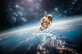 stock photo of surrealism  - Astronaut in outer space against the backdrop of the planet earth - JPG