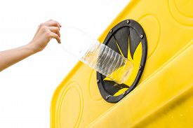stock photo of segregation  - Throwing a bottle into the recycling container - JPG