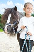 pic of pony  - beautiful little girl and a pony for a walk - JPG