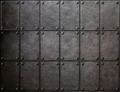 stock photo of ironclad  - knight armor metal texture with rivets background - JPG