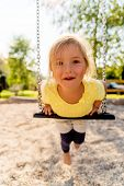 pic of swing  - funny swinging little cute smiling kid - JPG