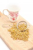stock photo of chamomile  - Chamomile tea Chamomile tea on the wooden table - JPG