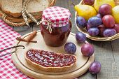 foto of fresh slice bread  - Plum jam with slices of bread and fresh plums and pears - JPG