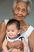 picture of grandmother  - Asian Grandmother with baby great grandmother holding great grandchild - JPG