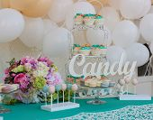 picture of wedding feast  - Cute candy bar with various candies and cakes