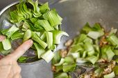 picture of chinese wok  - Stir frying Chinese cabbage on the wok - JPG