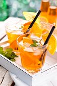 foto of refreshing  - Refreshing lemonade with oranges and mint on wooden table - JPG