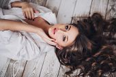 stock photo of sleeping beauty  - beautiful sexy girl with long hair in a man - JPG