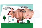 stock photo of peeking  - Young couple peeking through torn paper against painted blue wooden planks - JPG
