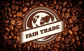 picture of trade  - Fair Trade graphic against heart indent in coffee beans - JPG