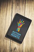 pic of autism  - Autism awareness month against overhead of tablet on desk - JPG