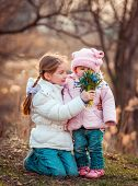 picture of little sister  - happy little sisters with  a bouquet of flowers - JPG