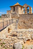 stock photo of yellow castle  - Medieval stone castle in ancient Calafell town Spain vertical photo - JPG