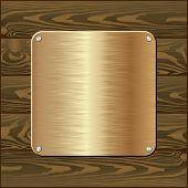 pic of plaque  - golden plaque on dark wooden wall   - JPG