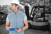 picture of pallet  - Architect writing on clip board against warehouse worker loading up pallet - JPG