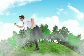 pic of running-late  - Geeky businessman running late against blue sky - JPG