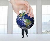 stock photo of presenting  - Hand presenting against room overlooking ocean - JPG