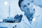 pic of scientific research  - Science graphic against scientific researcher looking at test tube while using microscope in lab - JPG