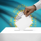 stock photo of south american flag  - Ballot box with US state flag on background  - JPG