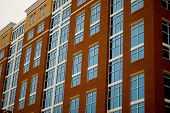 foto of commercial building  - a series of office windows on a red brick building - JPG