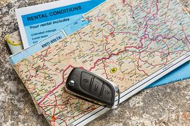 picture of rental agreement  - Car remote key on map and rental agreement - JPG