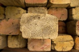stock photo of 2x4  - A stack of timber with one plank poking out - JPG