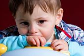 stock photo of pouty lips  - Baby taken close up with sad face - JPG