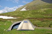Tourist Tent In A Mountain Landscape poster