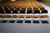 Постер, плакат: Endless Rows Of Chairs In A Modern Conference Hall