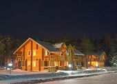 Wooden Cottage Under Night Sky