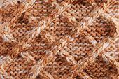 Close-up Of Knitted Cloth With Geometrical Pattern