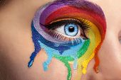 Постер, плакат: Flowing Colors On An Eye In Fashion Stage Make Up